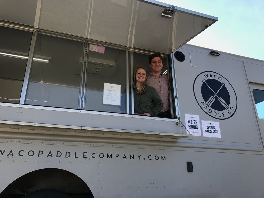 Waco Paddle Company owners Beth and Ross Harris inside the truck from which they operate boat rentals