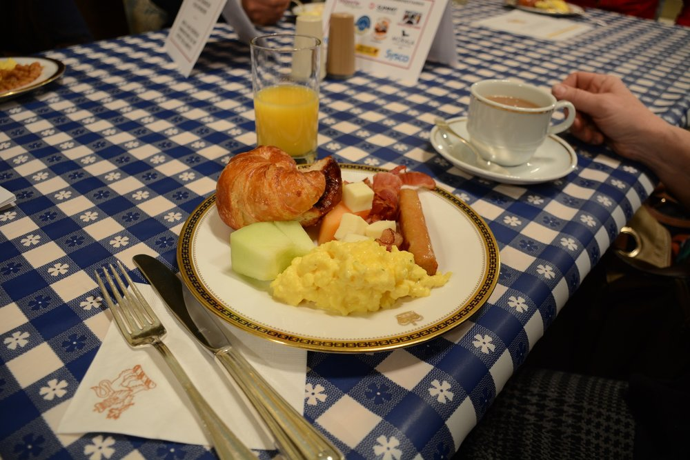 Fresh fruit, scrambled eggs, bacon, sausage, baked beans, pastries, coffee and juice were on the menu at the Governor General's charity breakfast