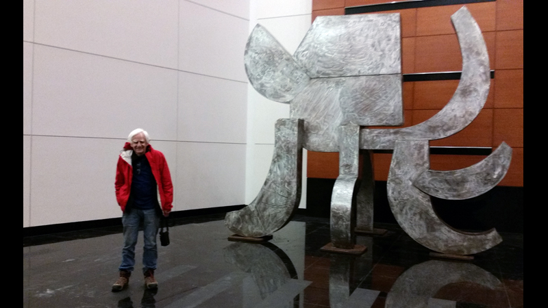 The artist and the elephant in the Fox Tower lobby, afternoon of the installation.