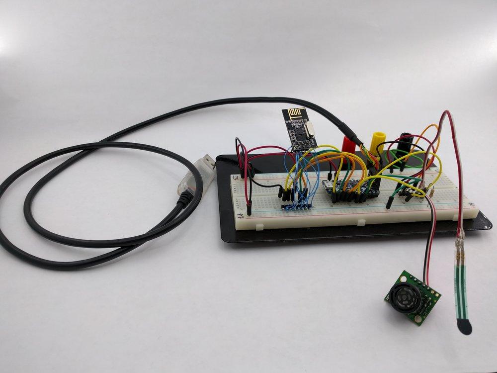 Transmitter prototype with Adafruit Pro Trinket 3V, nRF24L01+, with Sonar and FSR sensors.