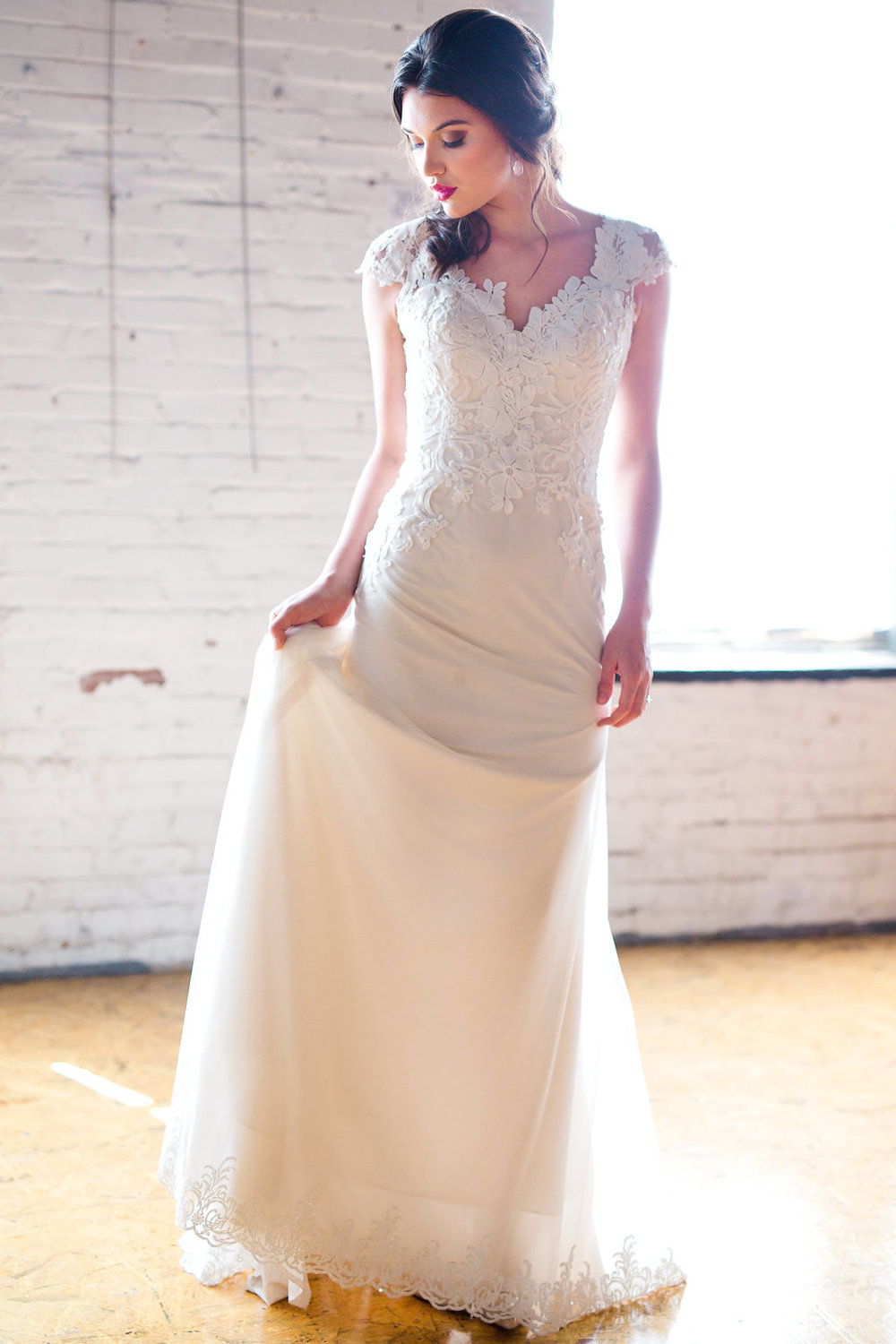 Gown: Lillian West from White Traditions Bridal House