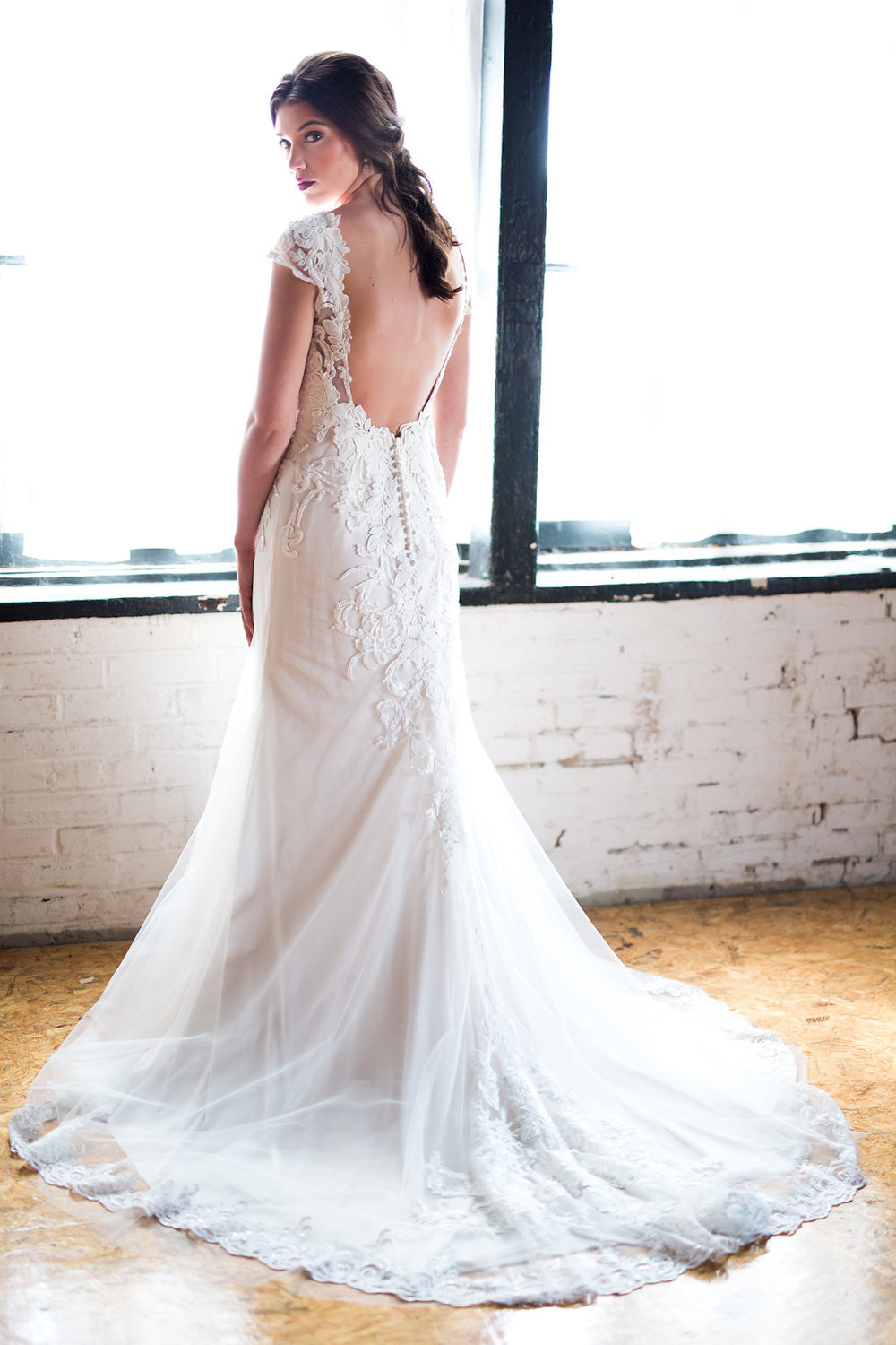 Gown: Lillian West via White Traditions Bridal House