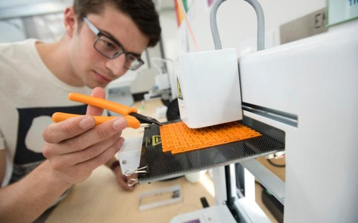 James examining a print on one of our Ideawerk RS printers