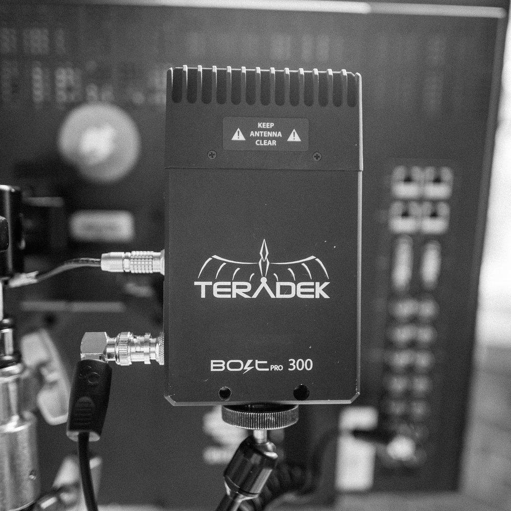 Teradek Bolt 300 Wireless Video Transmitter   120/day, 480/week, 90/day in studio   Zero latency uncompressed wireless video transmitter. 300 foot range. Includes SDI Transmitter and two receivers; one SDI and one HDMI. Both receivers can be used at once.  Also includes mounting accessories and cables for video io and power via AC, Dtap, or 2pin LEMO.   product info
