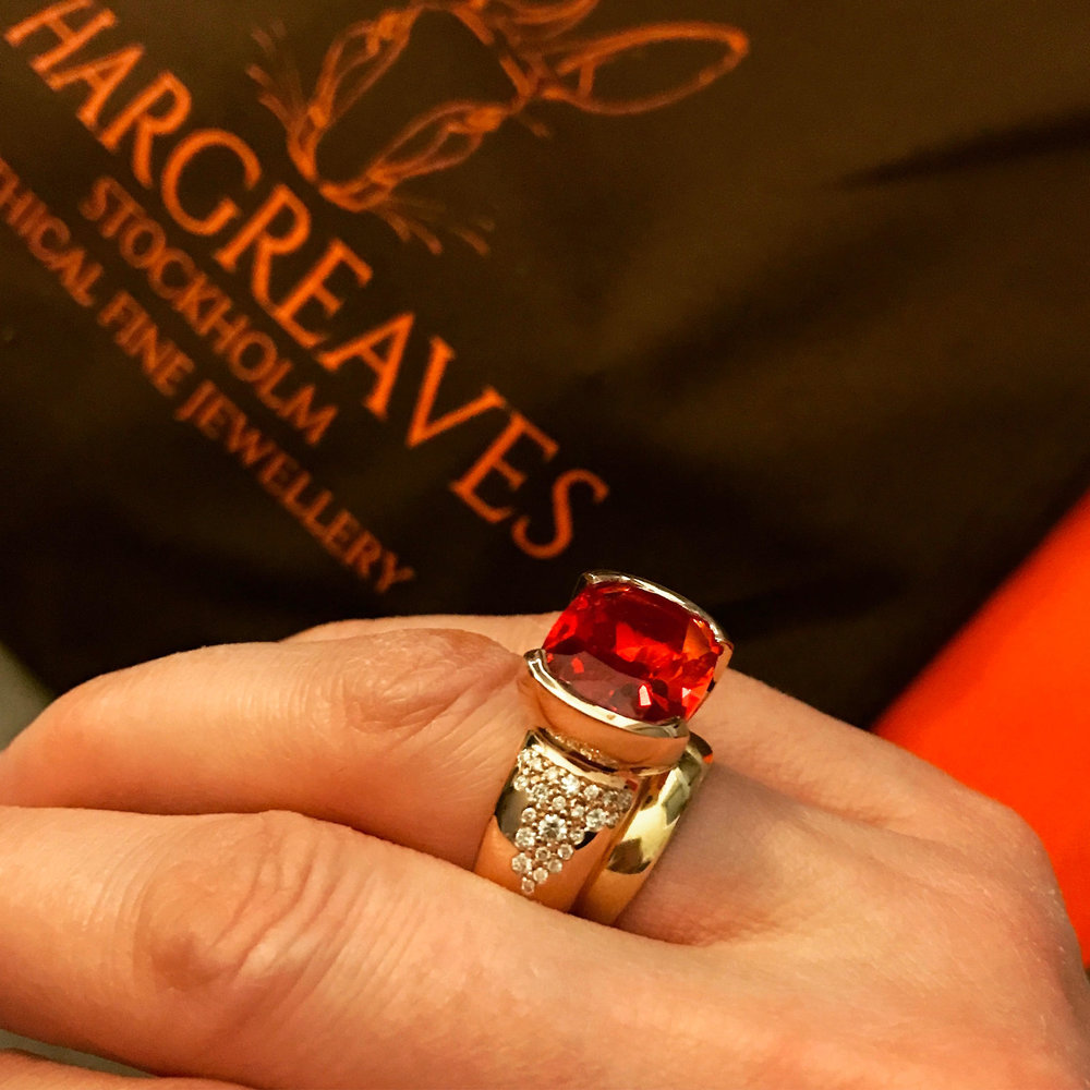 Our Freyr ring;18ct red Fairmined Eco gold set with an incredible cultured bright orange sapphire and a cascade of non mined diamonds.