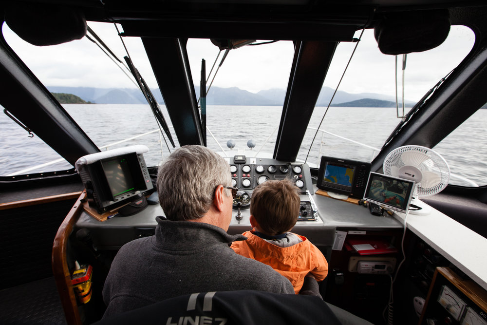 Sitting with Grandpa in the Captain's seat.