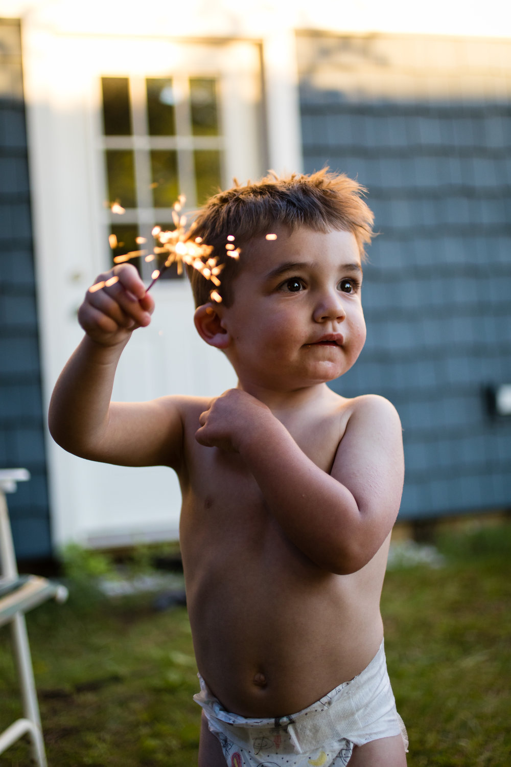 Showing off his safe sparkler holding.