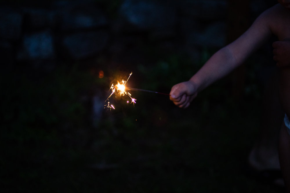 Lee's little hand holding the sparkler.
