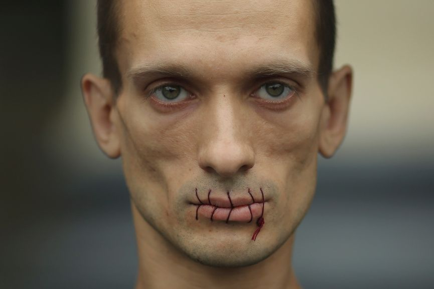 Pyotr Pavlensky. M outh sewn shut  in political protest against the incarceration of Pussy Riot members. July 23, 2012.