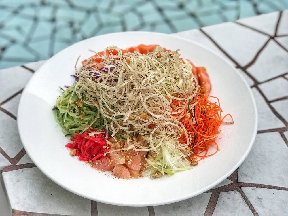 """Yúshēng"" (鱼生, aka ""Yee Sang"" & ""Yu Sang""), symbol of abundance, prosperity and good fortune. This is a dish traditionally eaten at a Lunar New Year feast with the family, a colourful platter of shredded vegetables, pickled ginger and salmon garnished with a tasty sauce."