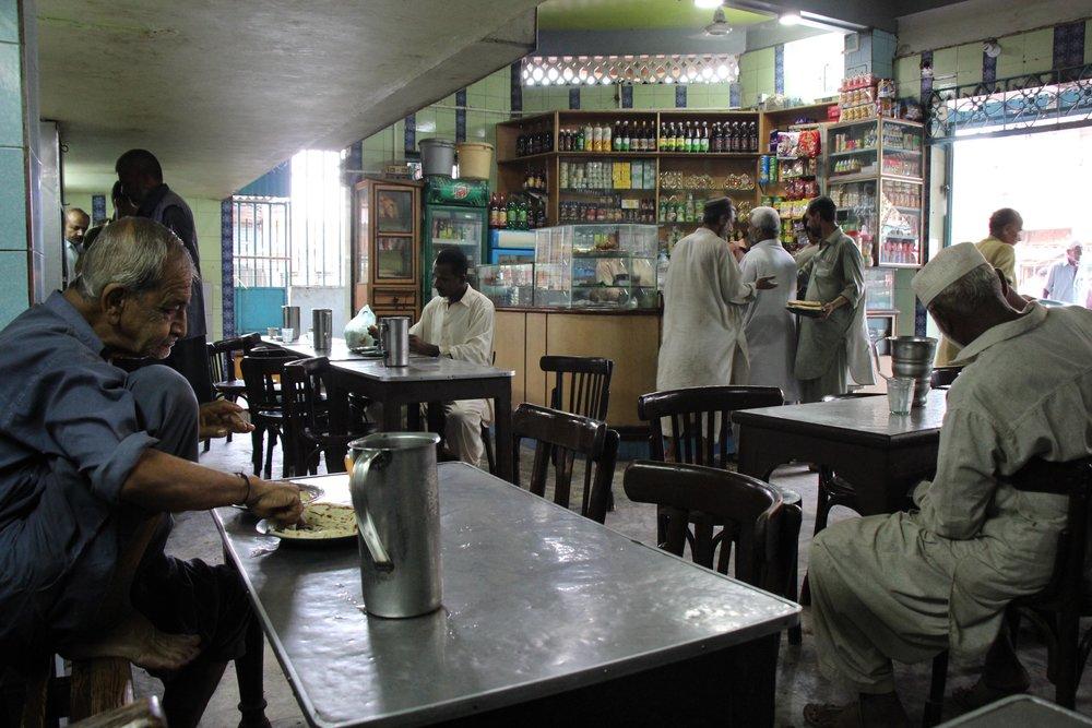 Early morning crowd at the Juna Masjid Malabari Hotel.