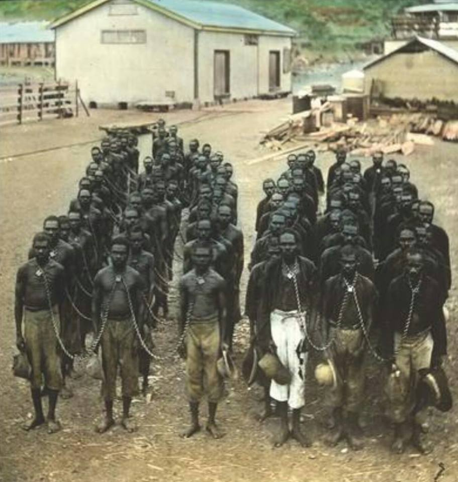 The photo, in front of Wyndham gaol, ironically, is designed to show that the treatment of Aboriginal prisoners in Western Australia was humane and orderly. It was issued following Dr Walter Roth's 'Royal Commission into the Treatment of the Natives.' Roth said the criminal justice system operating in the Kimberley was a 'brutal and outrageous state of affairs.' Men were arrested by police on horseback, usually without warrants or evidence on various East Kimberley pastoral stations that had been established on the Aboriginal country mostly in the 1880s.  Most (including at times children as young as ten ) were charged with the 'unlawful possession of beef' for allegedly spearing the introduced cattle and received sentences of up to three years gaol often including a flogging. On police patrols over several weeks or months up to 40 people at a time were caught and then neck chained together and forced to walk up to 300 km to gaol where, despite there being no regulation allowing it, the neck chains stayed on. Following senior police directives Aboriginal women were never arrested but were bought in with the same group. Not to act as witnesses for the defence but as witnesses for the prosecution. Again without any legal authority they too were neck or ankle chained. Prior to 1905 prisoners from Wyndham had their neck chains fastened with 'iron split links' that were extremely difficult to remove. The links were not police issue but purchased privately from an ironmonger in Perth. They could only be opened with 'a hammer and a chisel with the prisoners head on a blacksmiths anvil', a process that would take up to ten minutes. Most prisoners did not know what they were arrested for, why they were in gaol, or why they were being punished. Roth directed (among a litany of other issues) the government of the day to stop using neck chains although they were used in Western Australia until at least 1956.