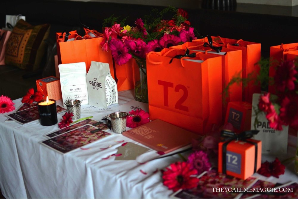 Goodie bags with treats from T2 Tea, Padre Coffee, Kakadu Plum Co, The Haus of Health and Flowers Vasette.
