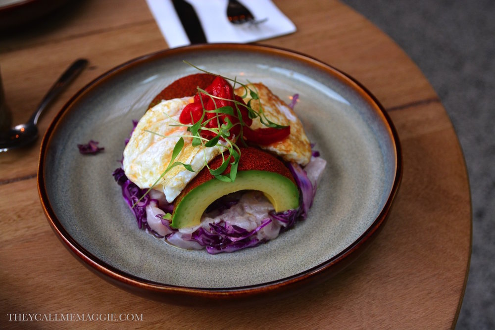 Ceviche of seasonal fish, cabbage salad, fried eggs, avocado, lime & pequillo peppers.