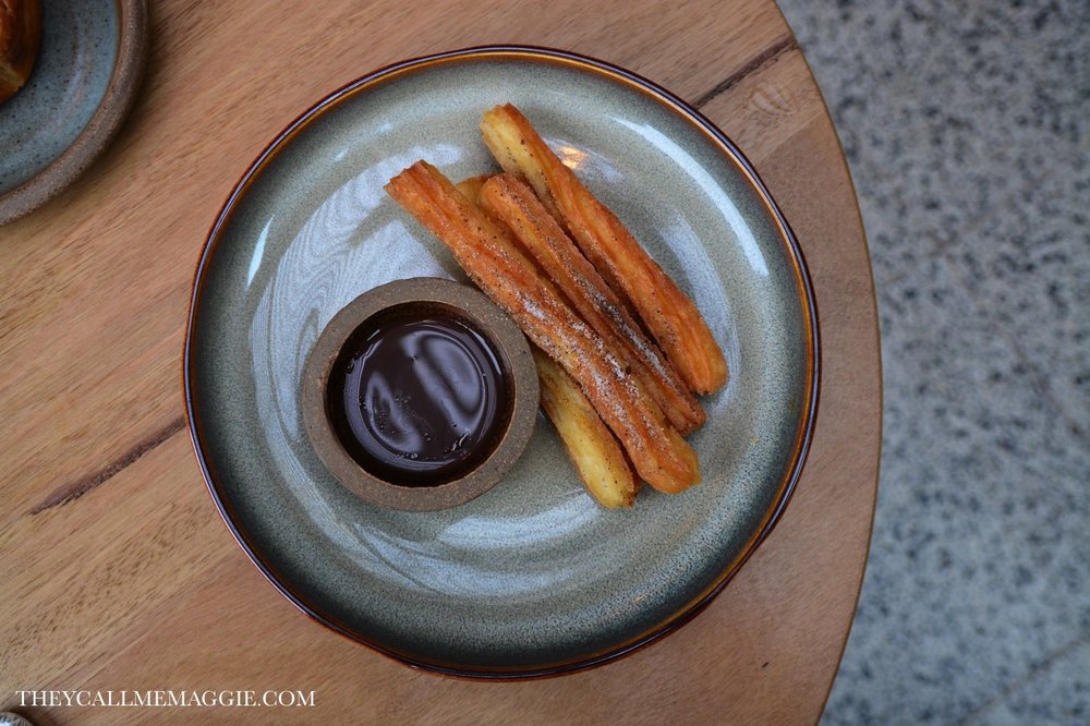 Nomada churros with coffee sugar & chocolate sauce.