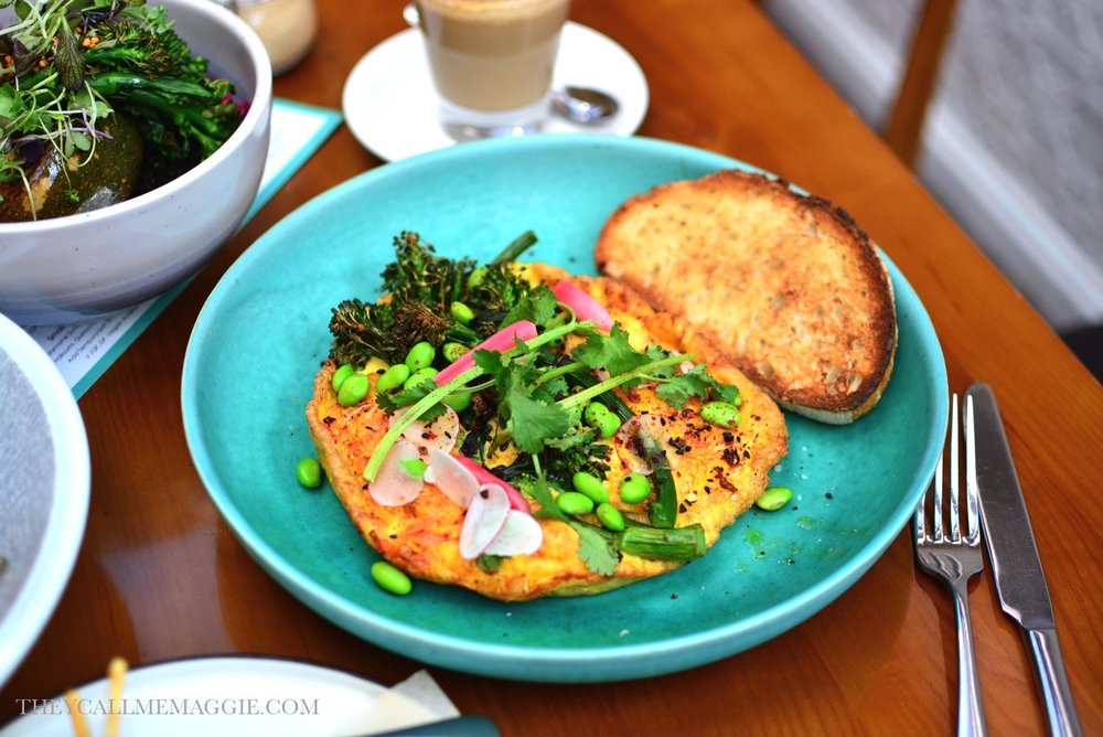 Kimchee omelette - 4 eggs omelette with house made kimchee, grilled broccolini, coriander, mozzarella, edamame and sourdough.
