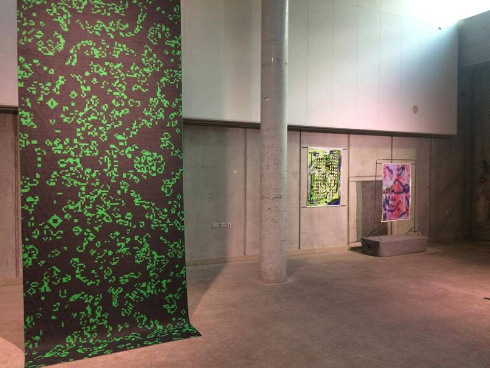 Installation view, Rethinking MATTER: Digital Materiality. LEFT: Anne-Sofie Overgaard, Untitled, digital weaving, 2016. RIGHT: Emilie Carlsen, Digital Realism Green, digital and analog printing on silk satin, 2015; Digital Realism - Pink, digital and analog print on viscose silk, 2015.