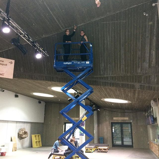 Pam and Nana up on the lift, installing work by Villiam Miklos.