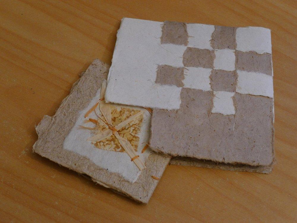 folded book in woven slip case