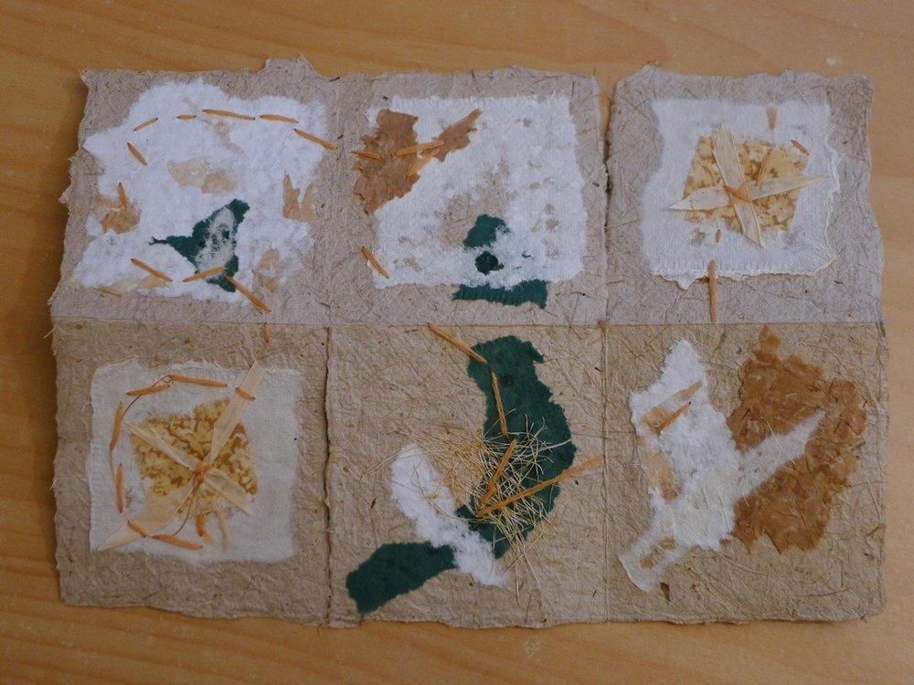hand-made paper, fabric, thread