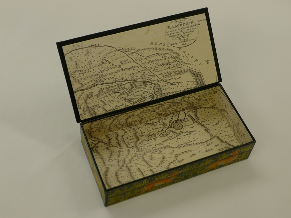 KASHMIR box and inside a map