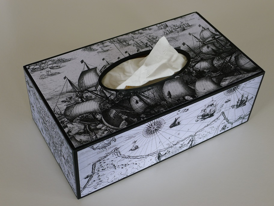 tissue box with maps and ships imagery