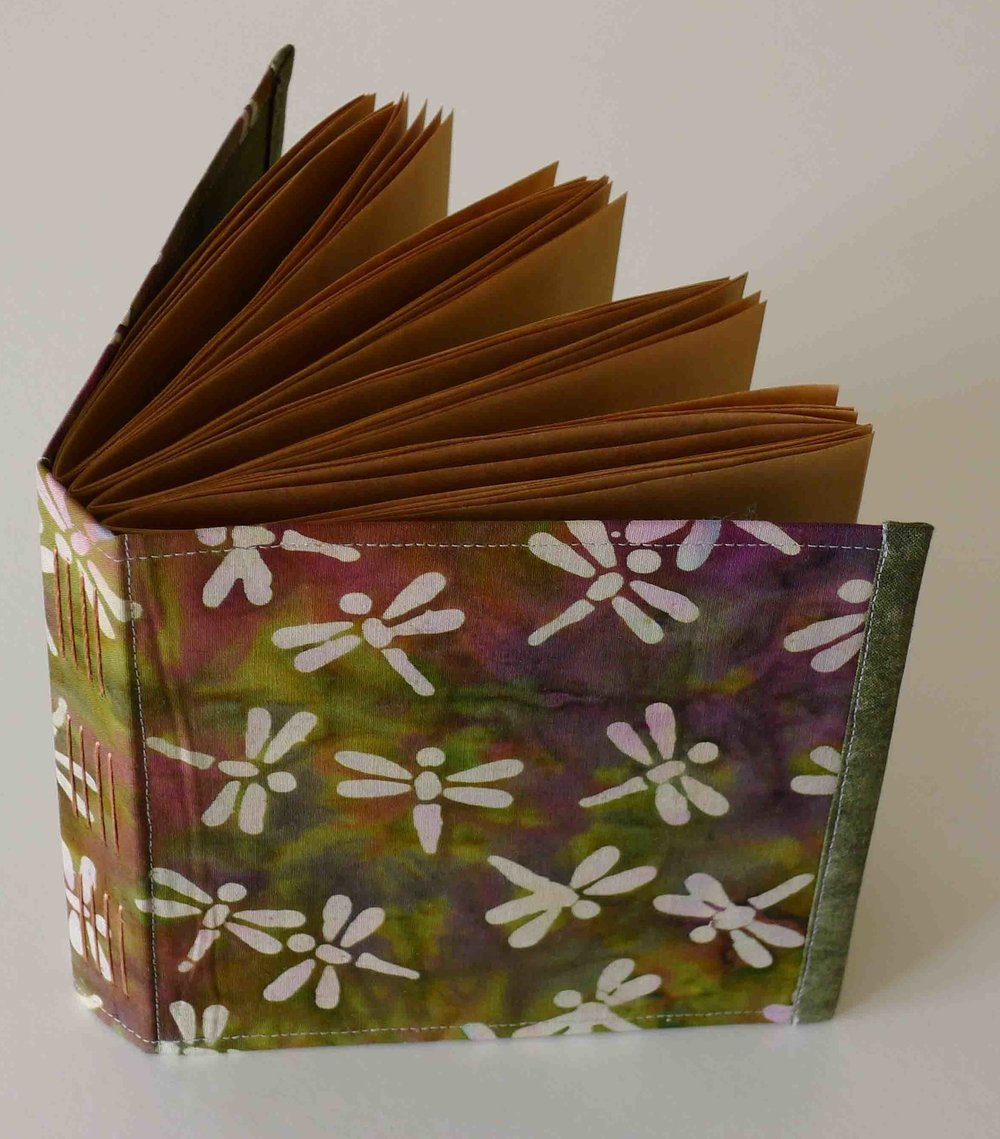 flexible fabric cover, brown paper pages
