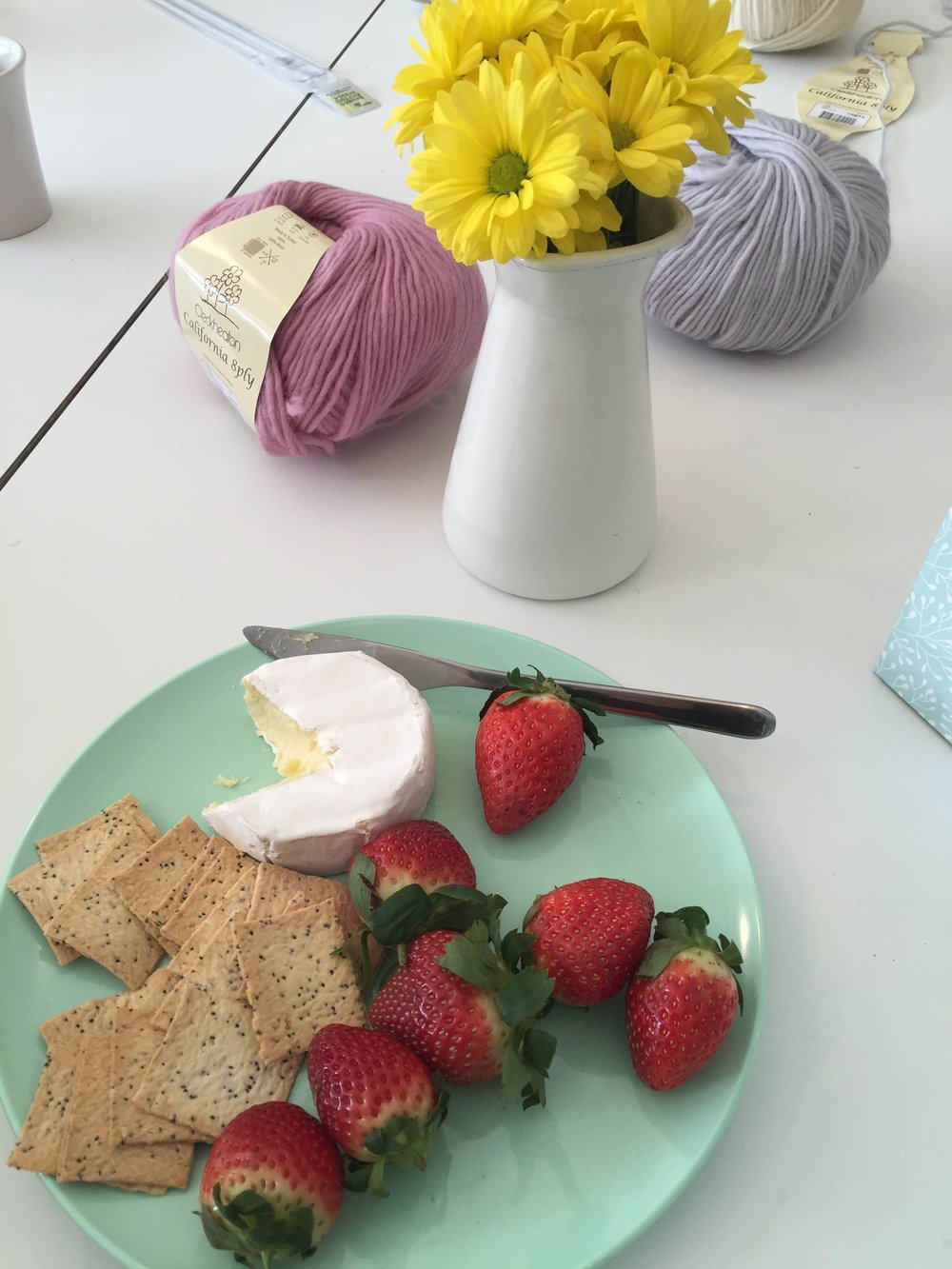 Because what is knitting without cheese and strawberries?