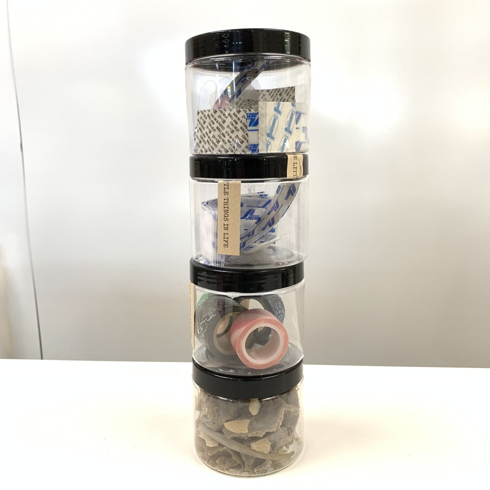 Stack Them - Put adhesive velcro to the top and bottom of each jar and stack them without worrying about them tumbling over