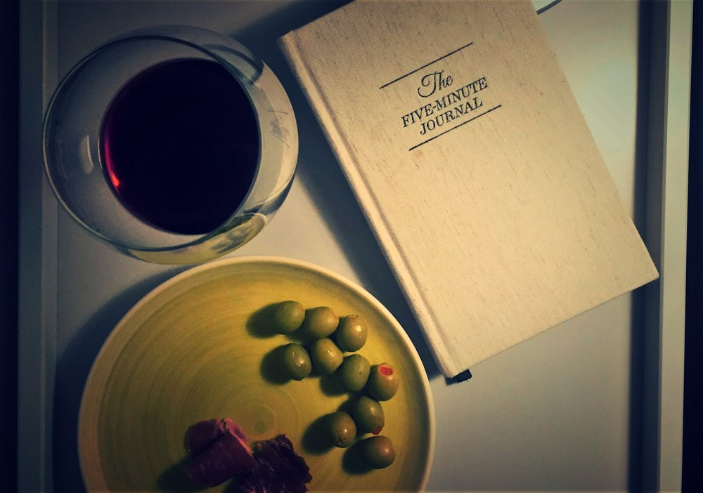 A few of my favorite things ... jamon serrano, Spanish olives, wine and, of course, my Five Minute Journal.
