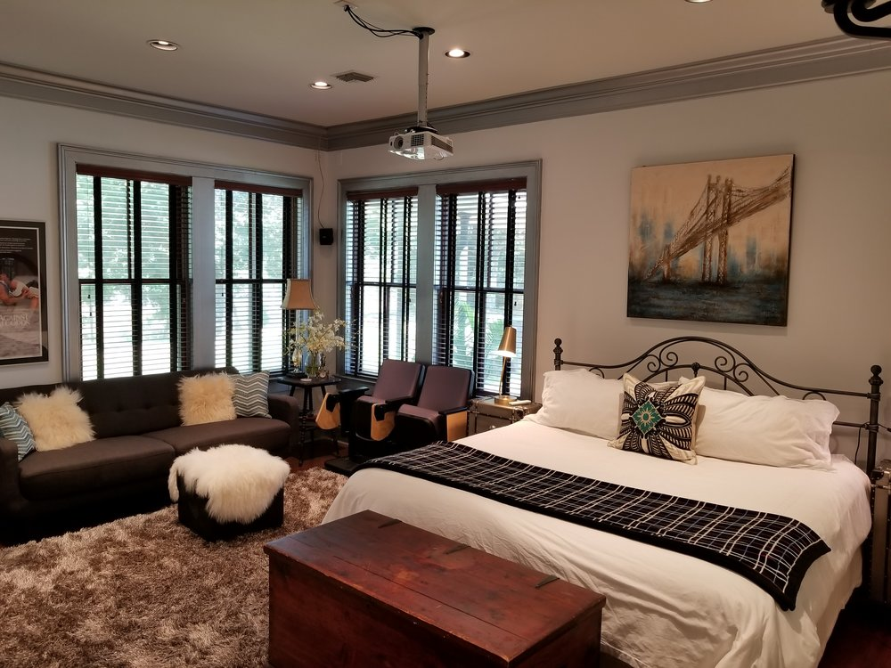 Bedroom Remodel - Making use of space in limited atmosphere. The room features a drop ceiling mounted projector. Rooms serves both as bedroom and theater. A 7.1 surround sound to finish off the affect.