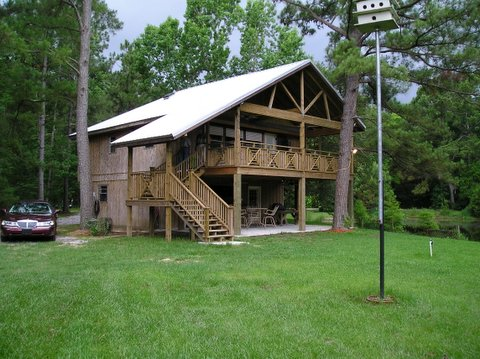 Camp - Roof and Porch addition. Railing and deck design by Getbilt, llc