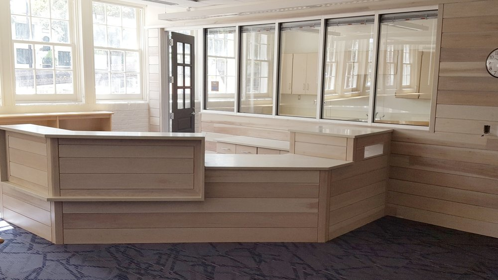 Library Circulation - Custom built cabinetry to match wall and building aesthetics. Serving the public is where we started. Areas such as these are one off and demand the best in quality to perform for many years.