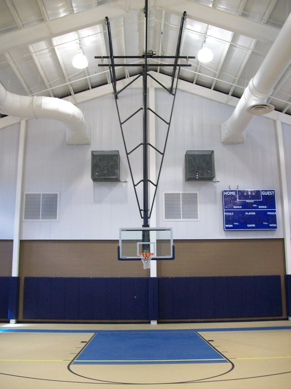 Multi Purpose - Gymnasium Equipment Construction - a staple in our construction business practices. Ceiling Mount Basketball complimented by wall pads.