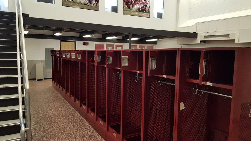 Lockers - Varsity High School Football Locker Room Restoration. Furnish and Install Open front lockers with security box and foot locker.