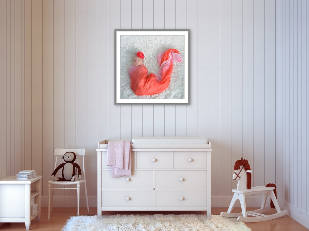 nursery wall with beautiful newborn image