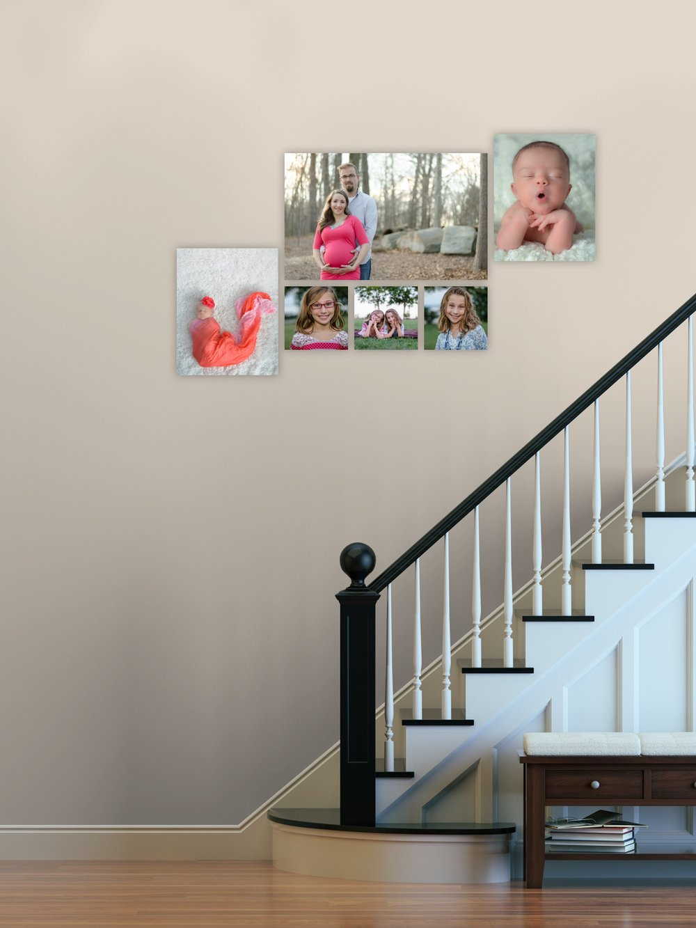 Family photographs going up a stair wall