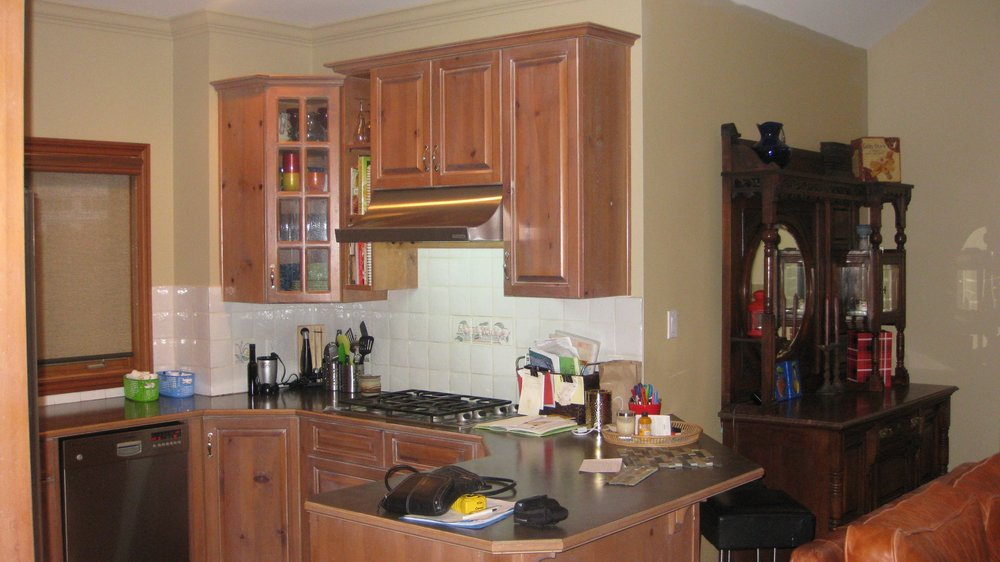 BEFORE: The Kitchen - Notice the white backsplash and the china buffet on the right.