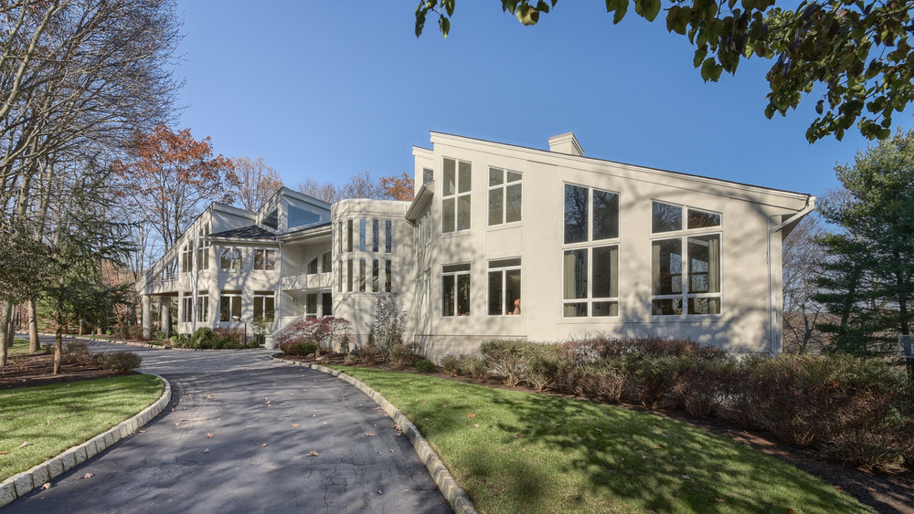 817 West Shore Drive,  Kinnelon   Exclusive Listing Asking $1,999,900  Prepare to have your breath taken away as only walls of glass separate this incredible modern home from it's stunning lakefront setting...