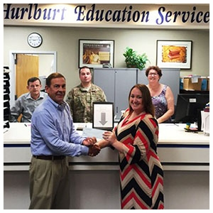 Keith Davis, Florida ACME Vice President, presenting a scholarship to Courtney Hill, 2016 Active Duty Spouse recipient.