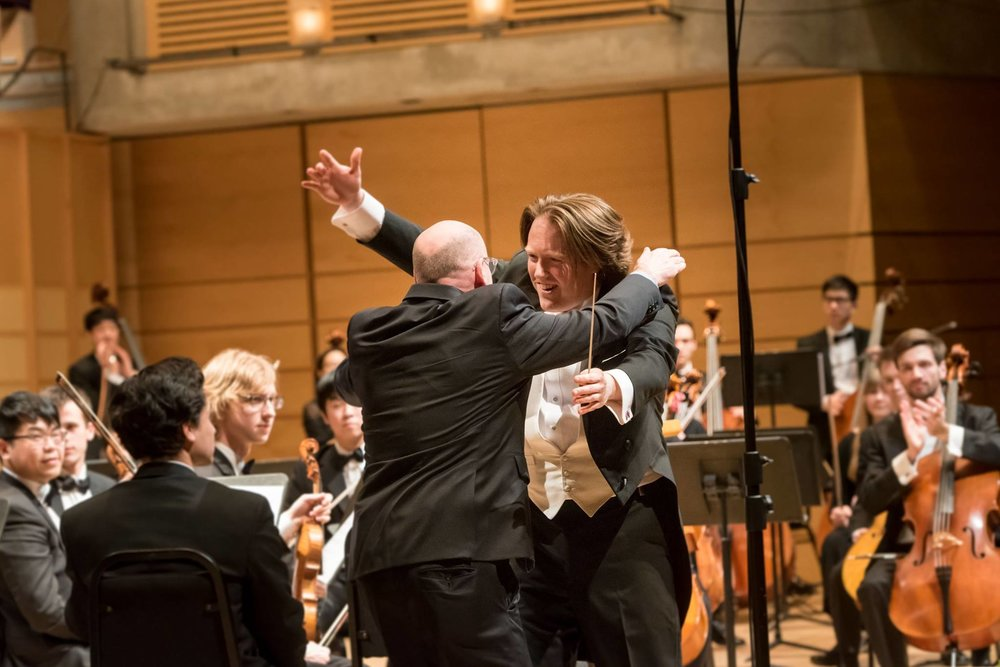 Dr. Jonathan Girard, director of UBC Symphony Orchestra, greets Dr. Richard Kurth after the performance of  A Song of Joys .  Photo: Paul Joseph/UBC