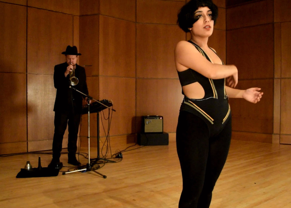 Kiran Bhumber demonstrates her Responsive User Body Suit.  Photo courtesy of Kiran Bhumber