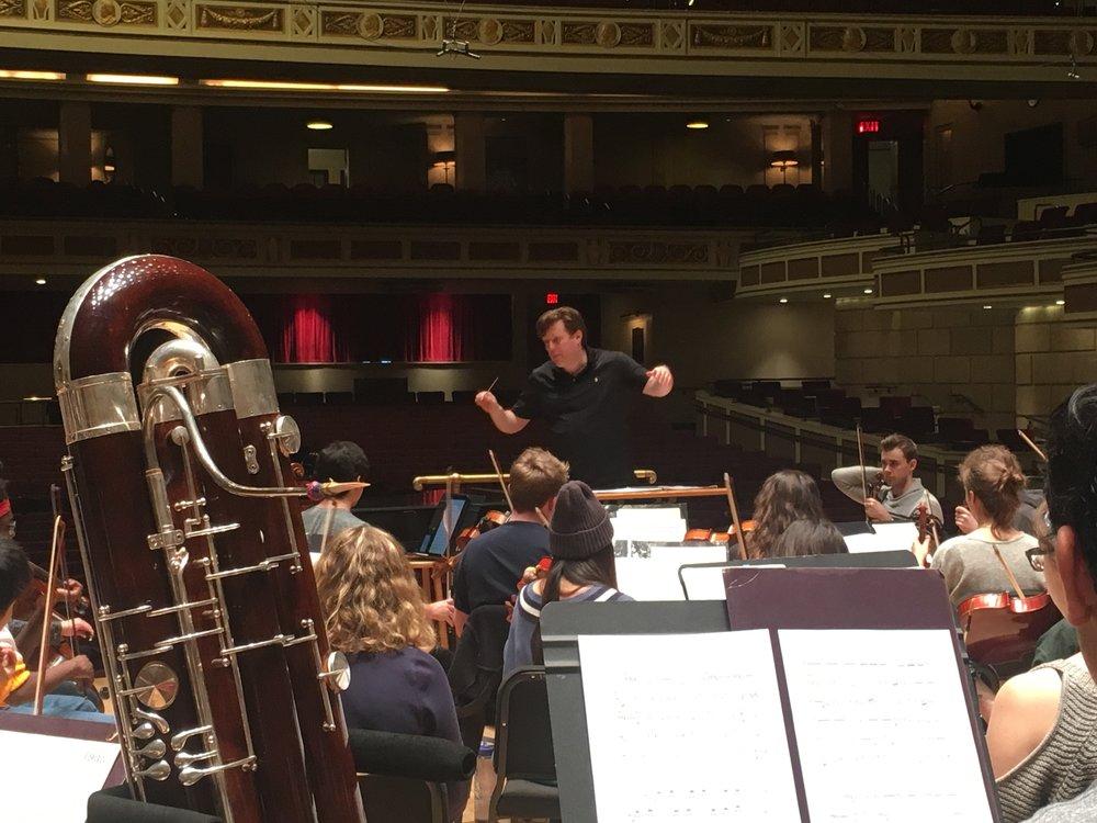 Dr. Jonathan Girard conducting the Eastman School Symphony Orchestra