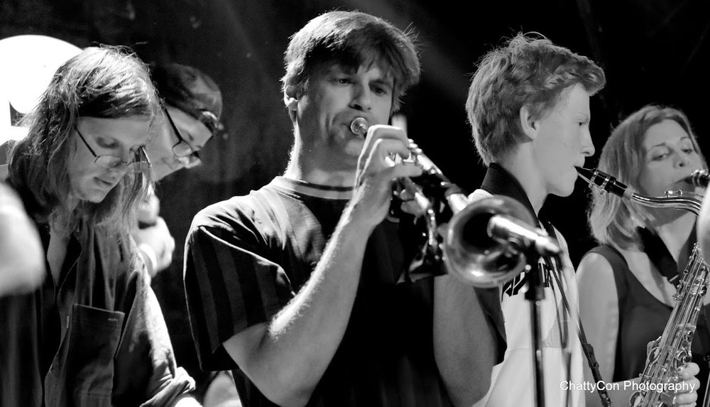 Keyboard and harmonica and trumpet and sax bnw.JPG