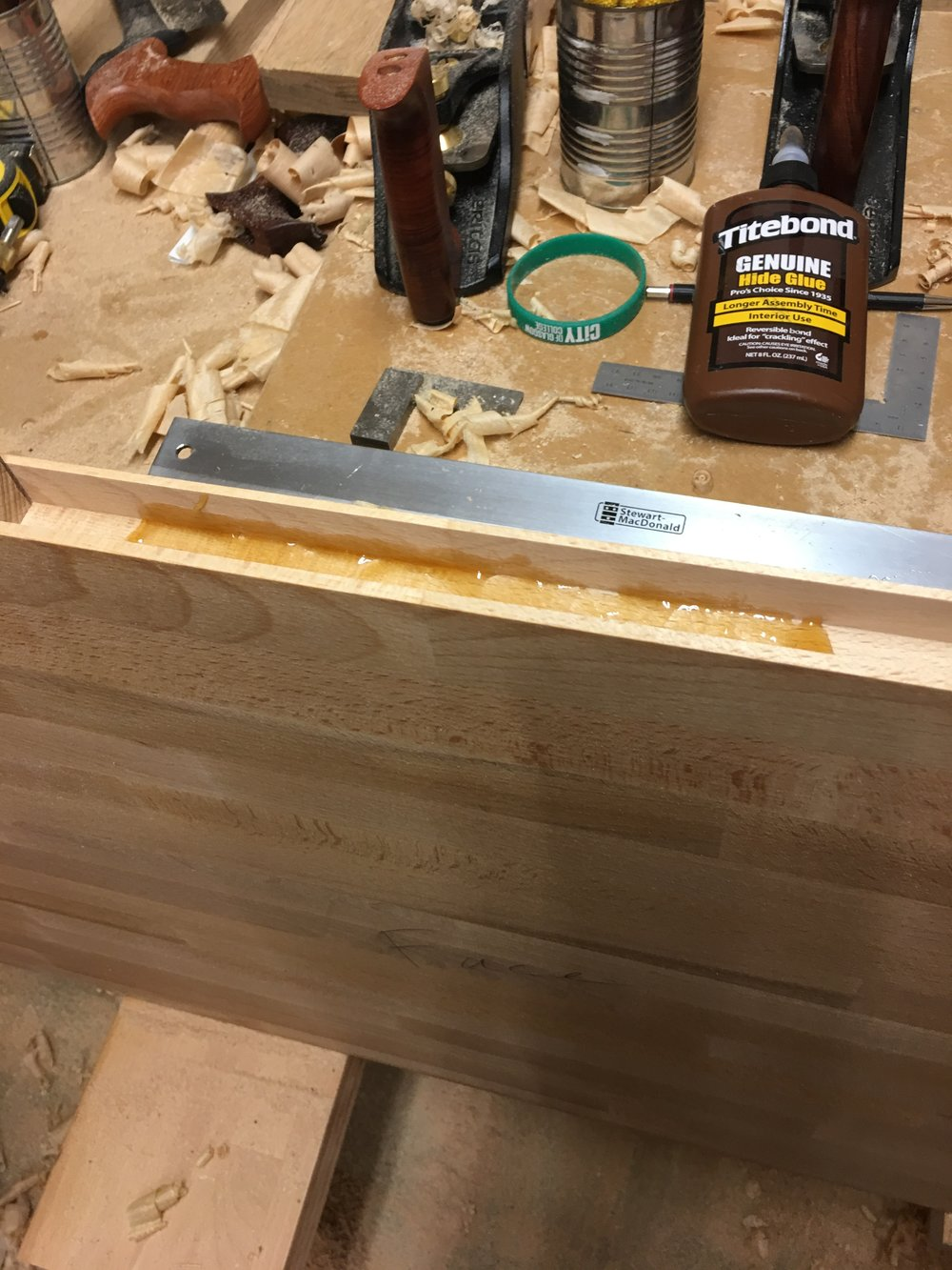 Gluing the tenons in.