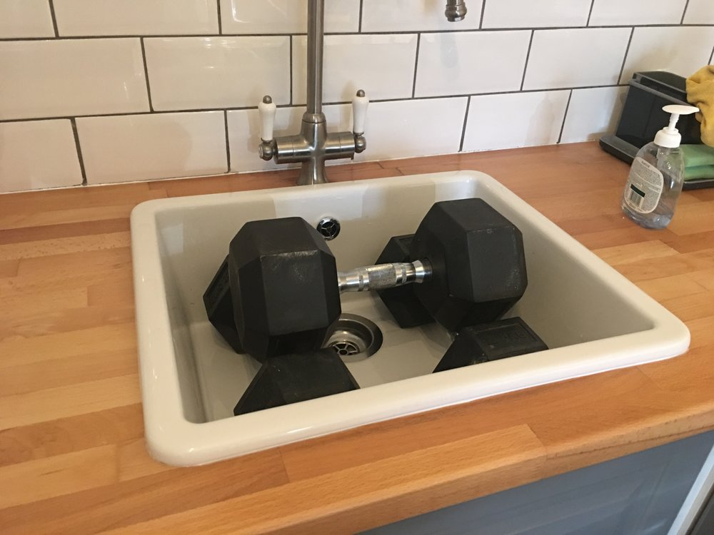Weighting the sink down while the silicone drys or washing my dumbells if you prefer.