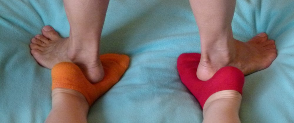 massaging feet with feet