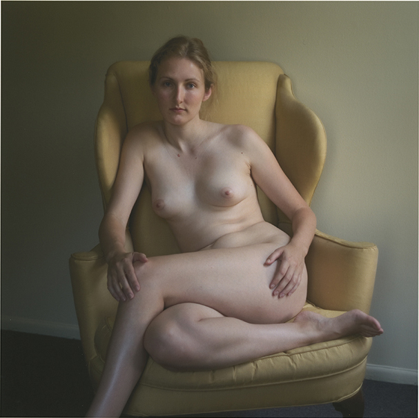 Valhalla , 2008  (Sarah seated in yellow armchair; leg crossed)  archival pigment print