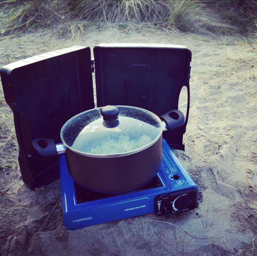 The stove, using the case as a wind break