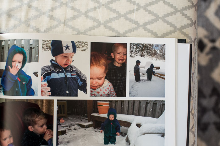 An open family photo book sits on a bench in Denver. Family Denver Photographer.